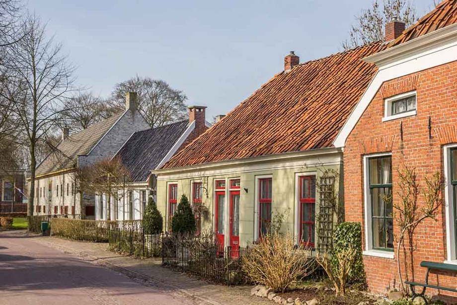 Old houses in a street in Oudeschans, Holland