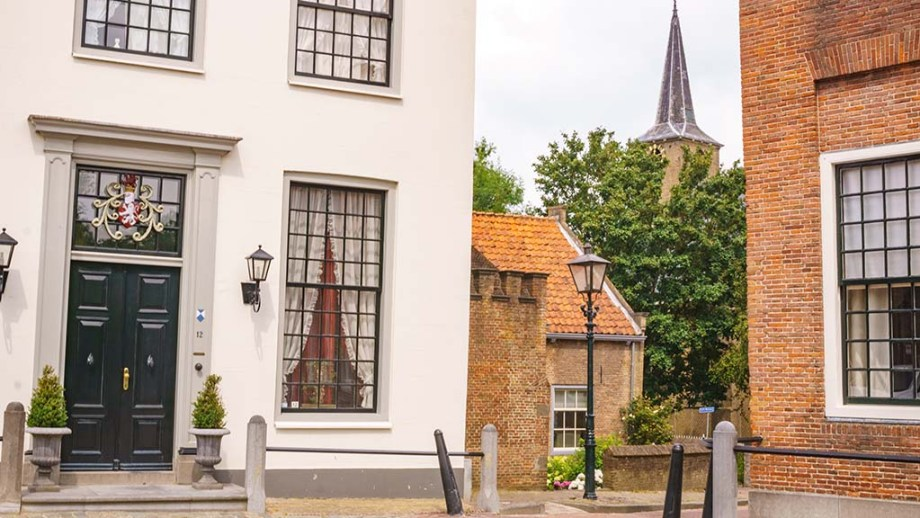 A view on a church tower from the main square in the village of Heenvliet