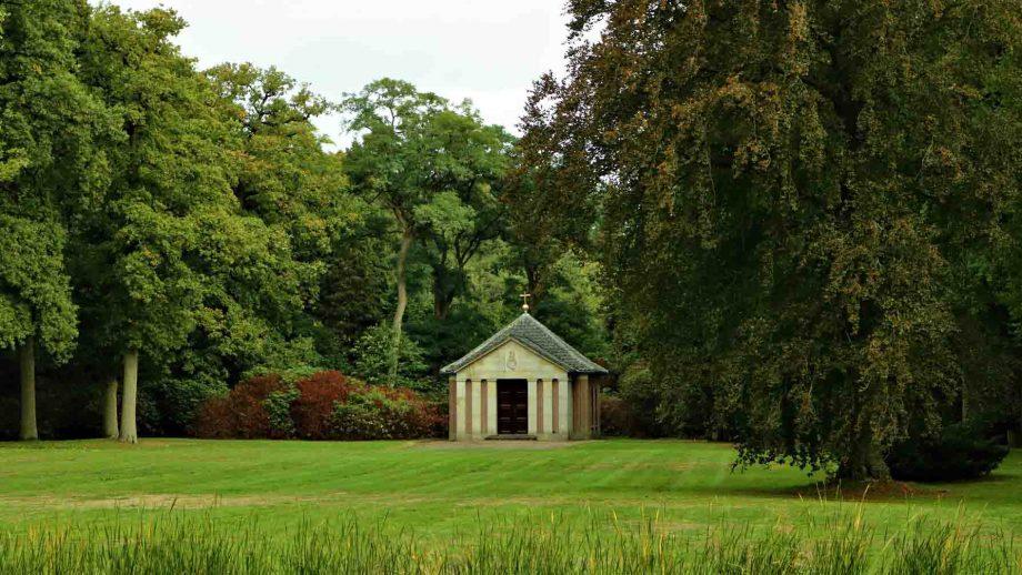 view on the mausoleum of German emperor Wilhelm between trees in Doorn, The Netherlands