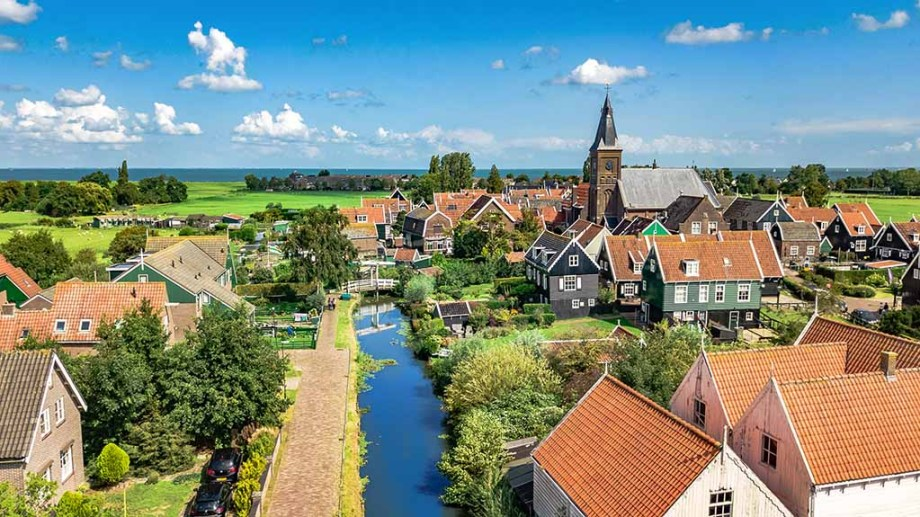 Aerial view on a canal that runs through the village of Marken island peninsula, The Netherlands