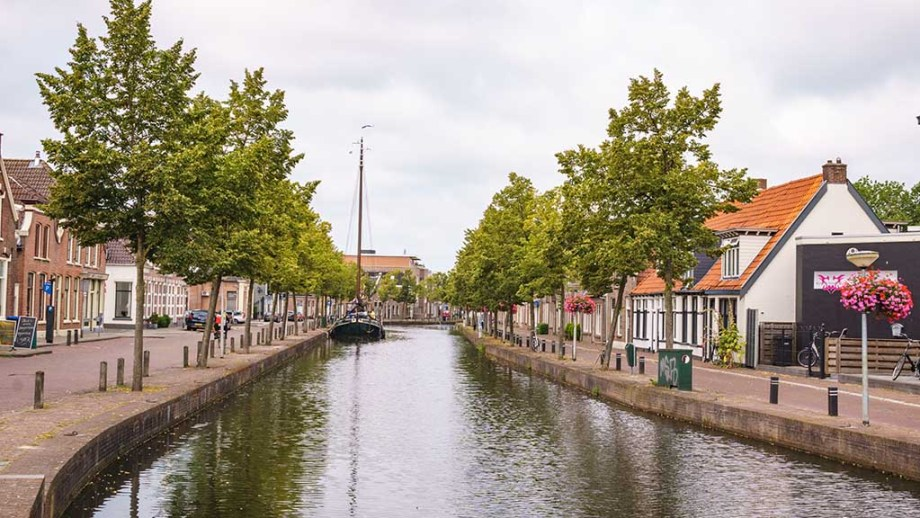 view on a canal, canal houses and cobblestoned street in the town of Meppel, Drenthe, The Netherlands