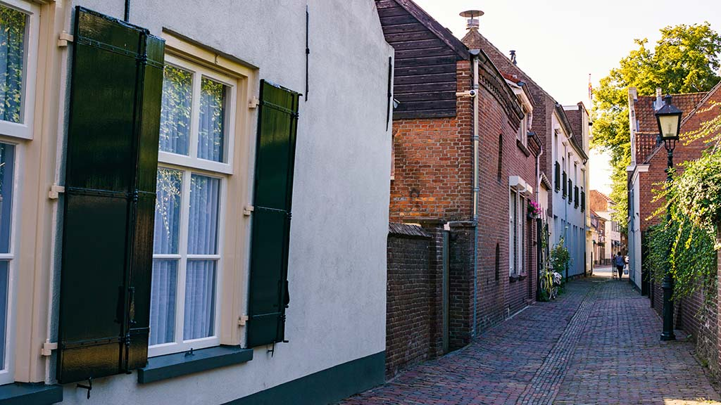 view on old Dutch houses along a cobblestoned street in the town of Oirschot, Noord- Brabant, The Netherlands
