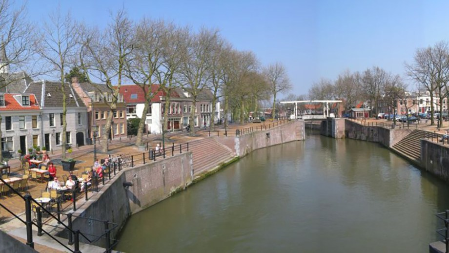 view on a sluice and harbour and canal houses in Vrreswijk, The Netherlands