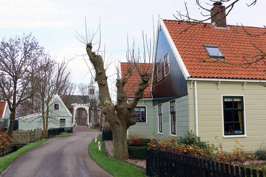 View on the village of Zuiderwoude and its Dutch wooden houses