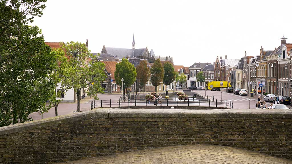 view of cobblestoned street and historic buildings in the city of Sneek, Friesland, The Netherlands