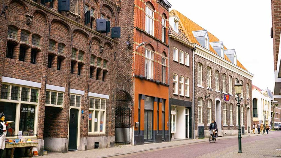 View on a cobblestoned street and historic buildings in the Dutch city of Venlo, Limburg, The Netherlands