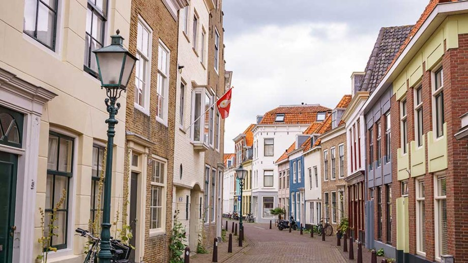 View on a picturesque street with canal houses in the city of Vlissingen, Zeeland, The Netherlands