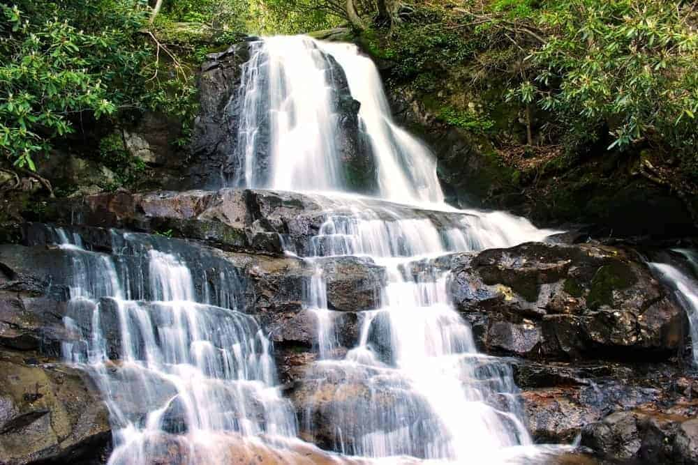 The roundtrip distance to the waterfall is 2.6 miles and the hike is considered moderate in difficulty. Top 5 Smoky Mountain Hiking Trails With Waterfalls For Families To Enjoy