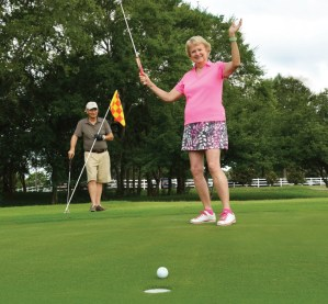 TOC Hip replacement patient Sheila Hershey on the golf course