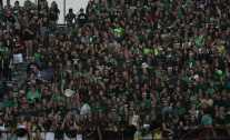 The student section creates a sea of green during the game.