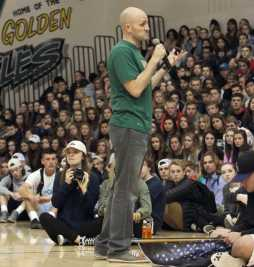 Jason Fisher performs a slam poem with Brian Wood to the seniors.