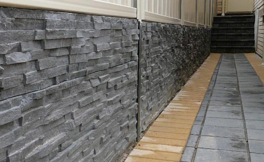 Kensington concrete sleeper retaining wall