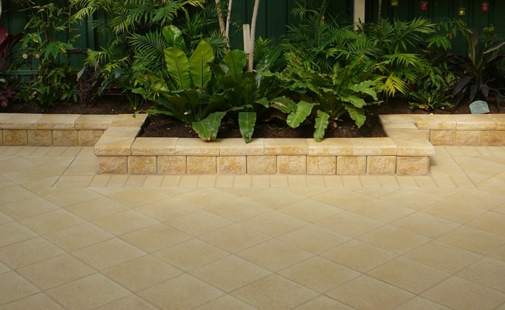 Matching pavers and capping for concrete block walls