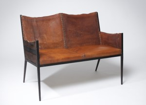 "Iconic leather seat. ""Throw out and keep throwing out. Elegance means elimination."" JM Frank"