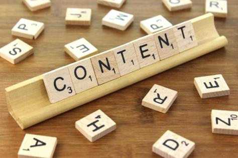 Wooden tiles spelling the word 'Content'