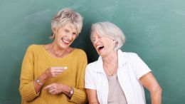 two ladies laughing - funny bone