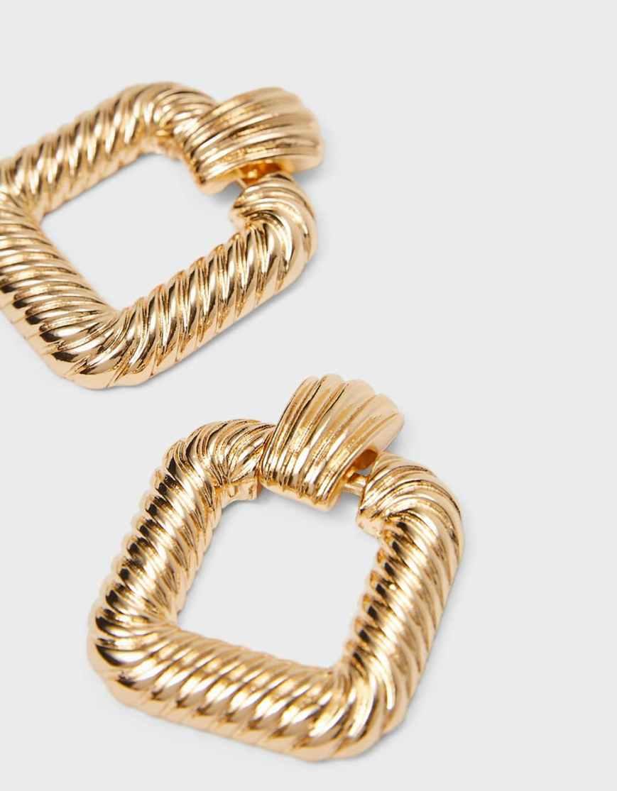 orecchini dorati anni 90