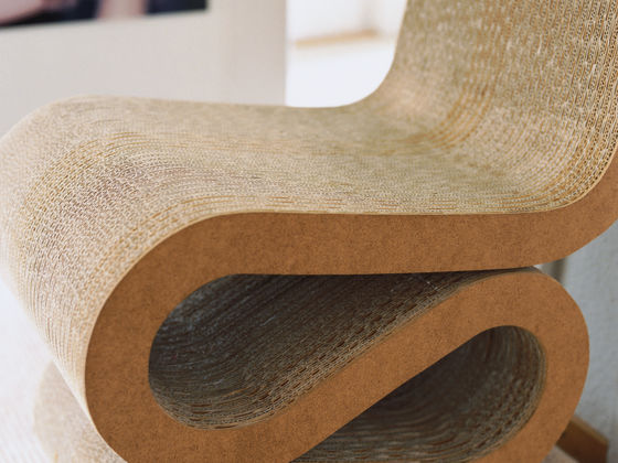 frank gehry cardboard chairs wheelchair table vitra wiggle side chair the architect is known for his use of unusual materials with 1972 furniture series easy edges he succeeded in bringing a new aesthetic