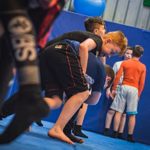 Corey working the takedown in the kids MMA class