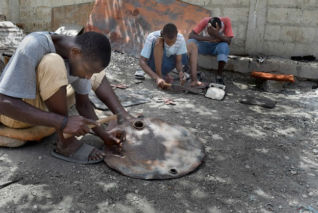 Haitian artisans recycle trash into art