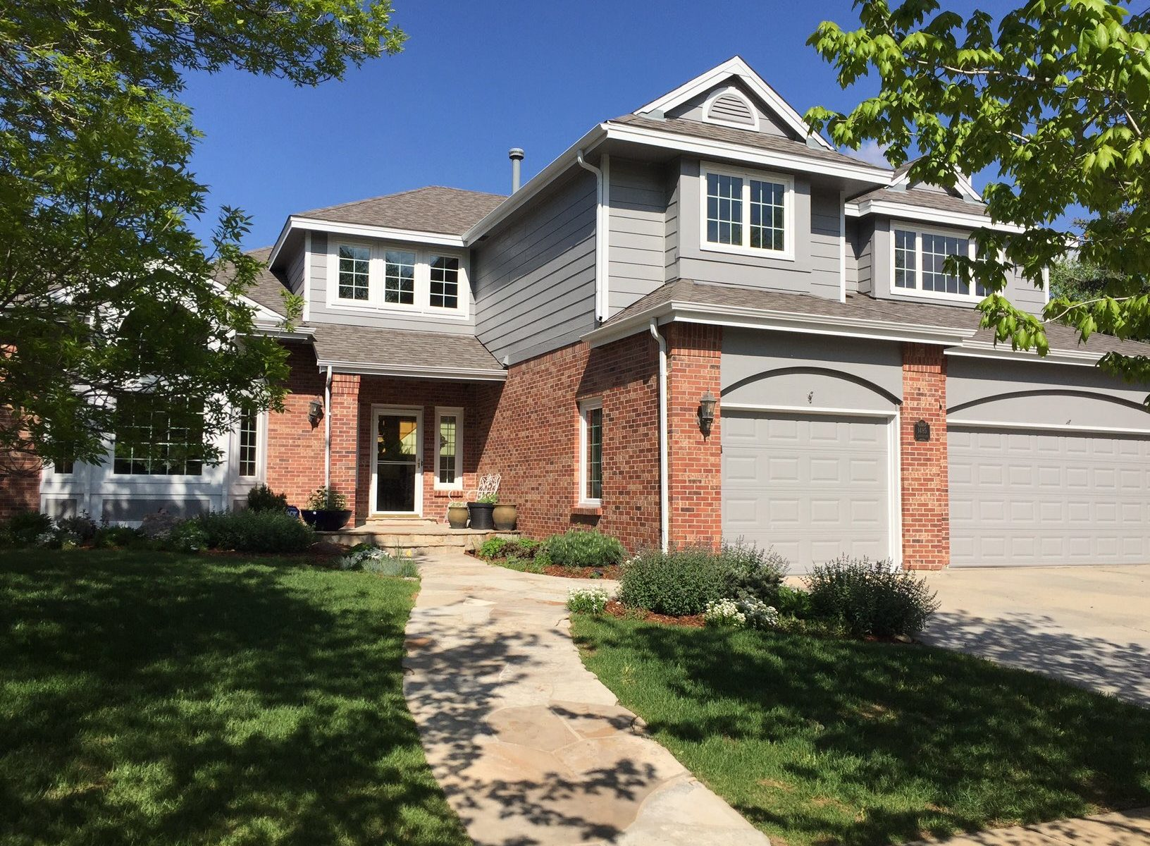 Light grey house with red brick garage  Vivax Pros