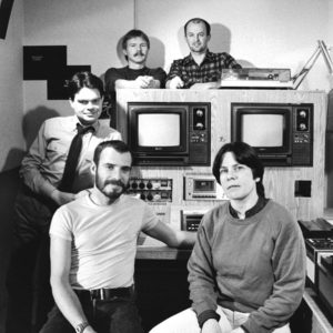 Portrait (c1980): Gayblevision Producers Top L-R: Don Durrell, Verne Powers Standing: Don Larventz Bottom L-R: Gregg Cutts, Mary Anne McEwen  Gregg Cutts, Mary Anne McEwen and Verne Powers were the original founders of Gayblevision. Don Larventz was a Producer and Host. Don Durrell was Producer and President of the GBV-Gayblevision Society.