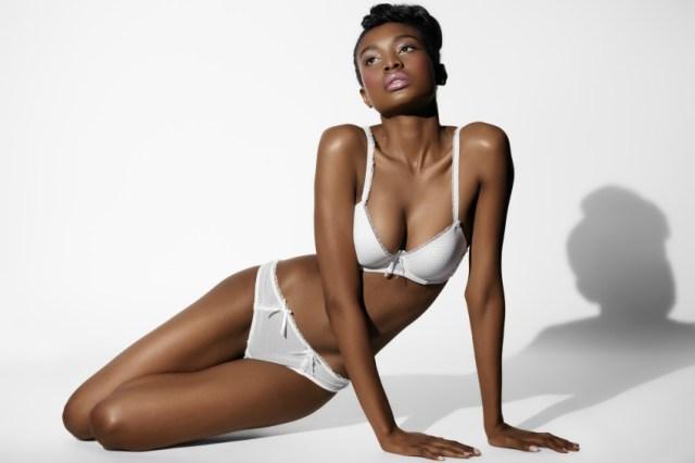 African model posing in white lingerie.