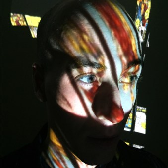 Lewis Casey with Projector Light - Photo by Carrie Gates
