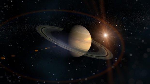Исследователи NASA сообщили что на спутнике Сатурна есть красные шрамы