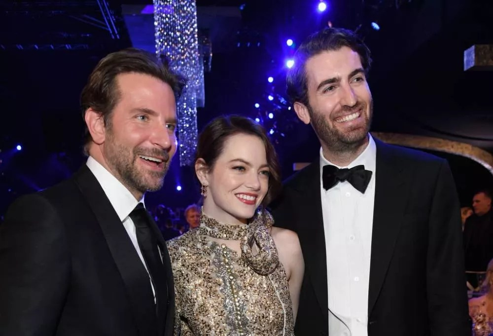 Emma Stone with her husband, Dave McCary and Bradley Cooper (Photo: Getty Images)
