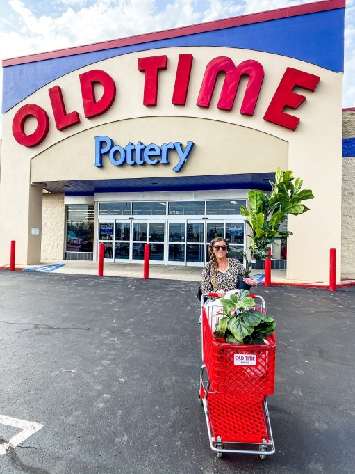 Savilla Mountain standing in front of Old Time Pottery iwth a full cart of décor