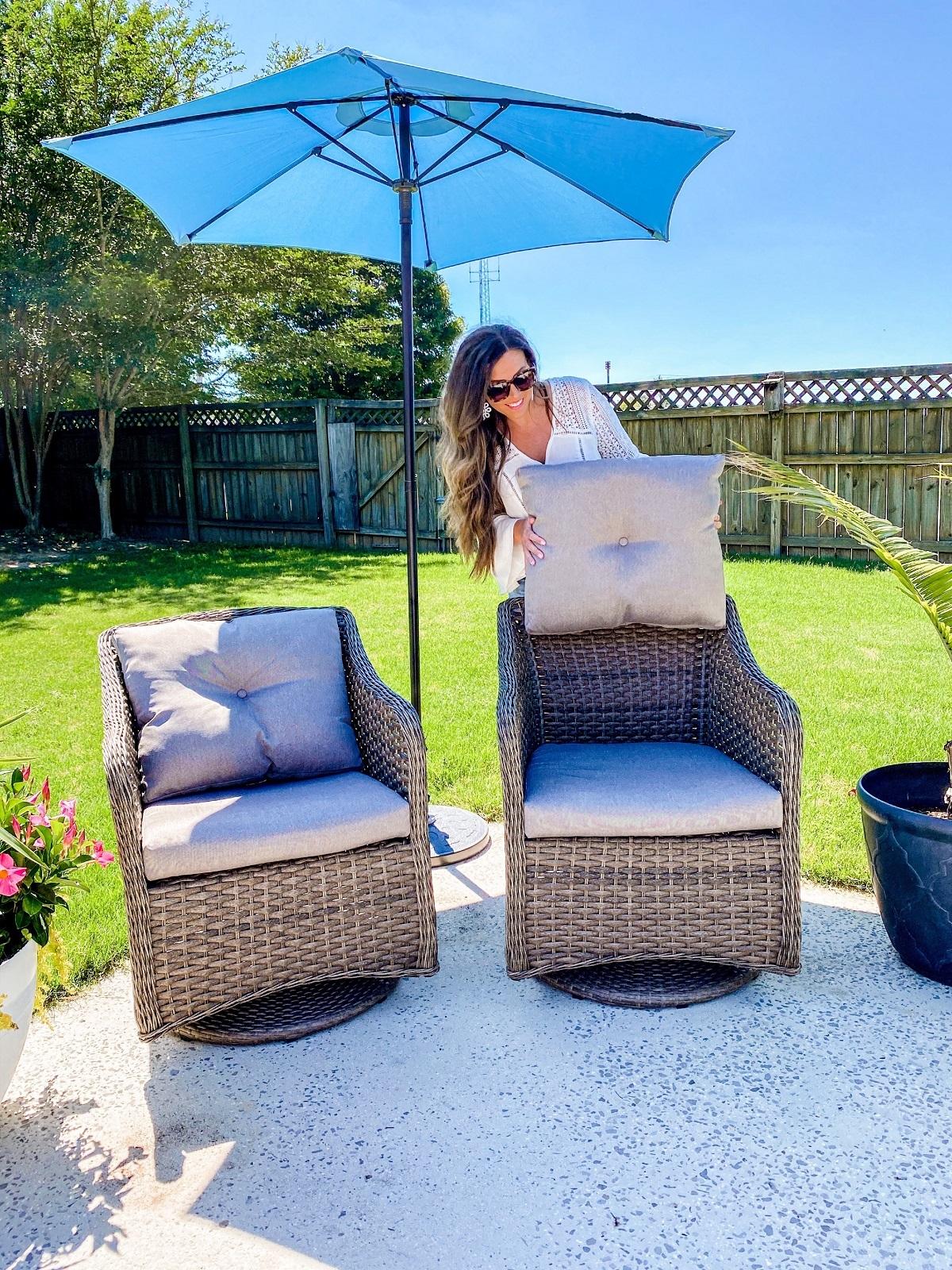 Savilla Mountain setting a cushion on this comfy outdoor chair