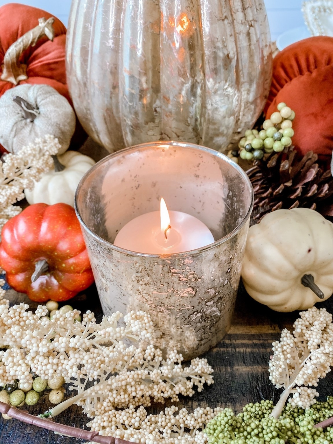 A lit candle for cozy fall vibes
