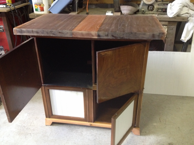 counter piece on top of cabinet is dark wood with a light strip on the middle. The bottom doors are now white