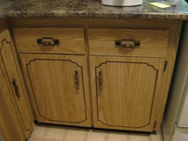 new granite-look counter top with old, dated wood-look cupboard doors still in place below it