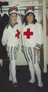 Maureen Holloway and I in our stretcher-bearer costumes with big red crosses on the chest, smiling for the camera