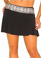 pair of tanned legs with a short black skirt