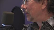 screen clip of Derek speaking into a windscreened mic