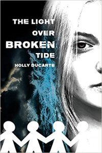 Book cover is grey-scale with a bit of blue and half the face of a teenage girl with a line of paper dolls at the bottom