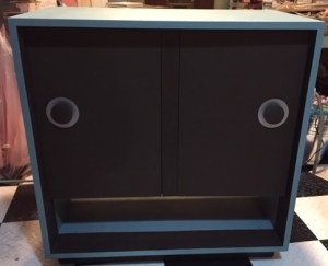 cabinet with a blue-green coating on the top and sides