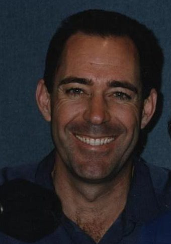 Barry Williams cropped out of a photo of him and me