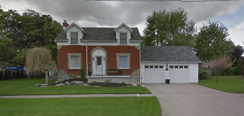 Our new place - brick front with a two car garage, two storey home. Has steel roof and dormers on the front