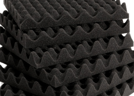 Twelve-inch squares of acoustic foam in a pile