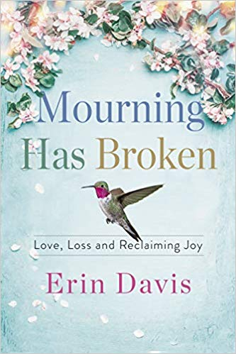 The cover of Erin's book is light blue with a hummingbird on it