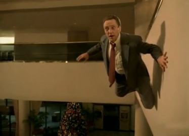 A still shot from the Weapon of Choice video where Christopher Walken appears to be floating near a hotel wall