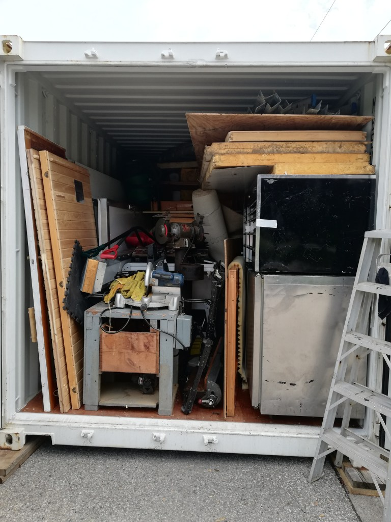 The inside of the container, packed solid until about the halfway point. Then it's machinery, stacked wood and pieces of insulation.