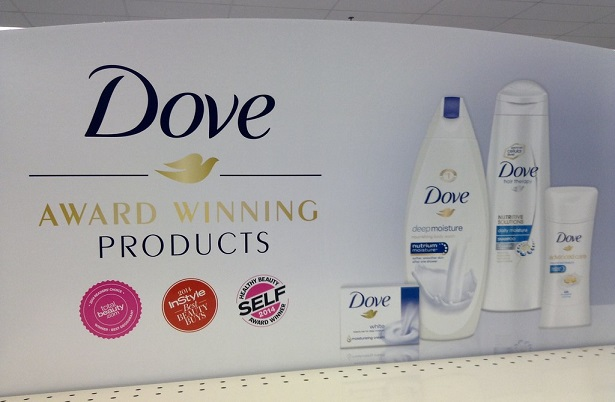 Dove product poster in-store shows soap, shampoo etc and the logo