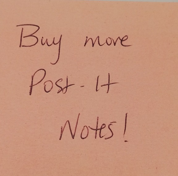 Pink post-it note on which I've written, buy more post-it notes!