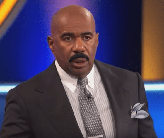 Steve Harvey looking stunned by something a contestant said on Family Feud.