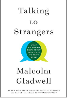 Book cover of Talking to Strangers by Malcolm Gladwell in simple white with black text. Blue and yellow conversation bubbles overlap in the middle.